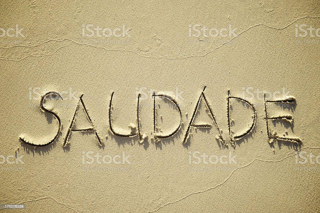 Saudade Brazilian Culture Portuguese Vocabulary Nostalgia Word in Sand stock photo
