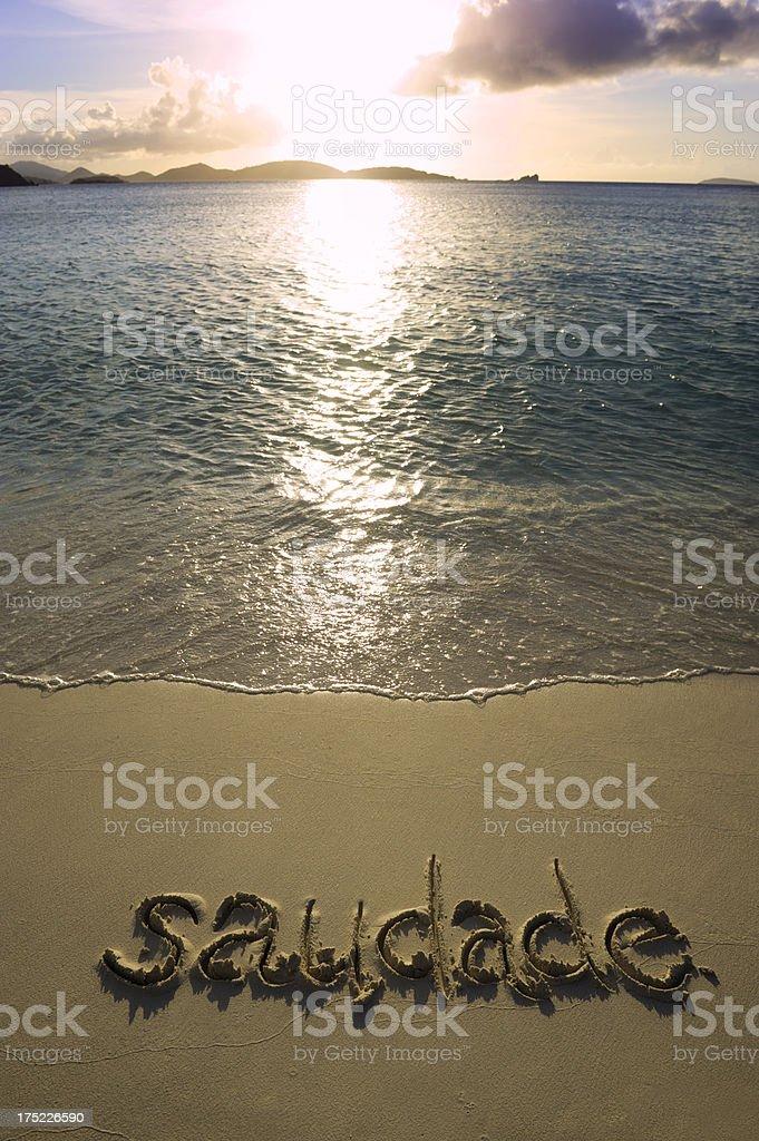 Saudade Brazilian Culture Portuguese Vocabulary Nostalgia Word in Sand royalty-free stock photo