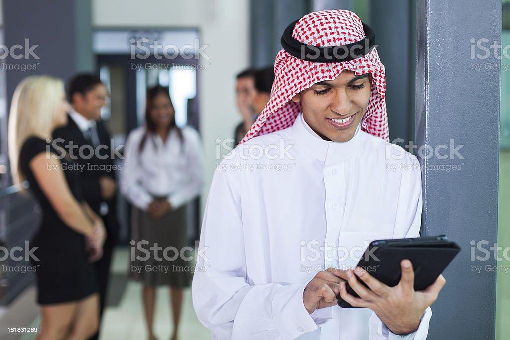 saudi arabian businessman using tablet computer royalty-free stock photo