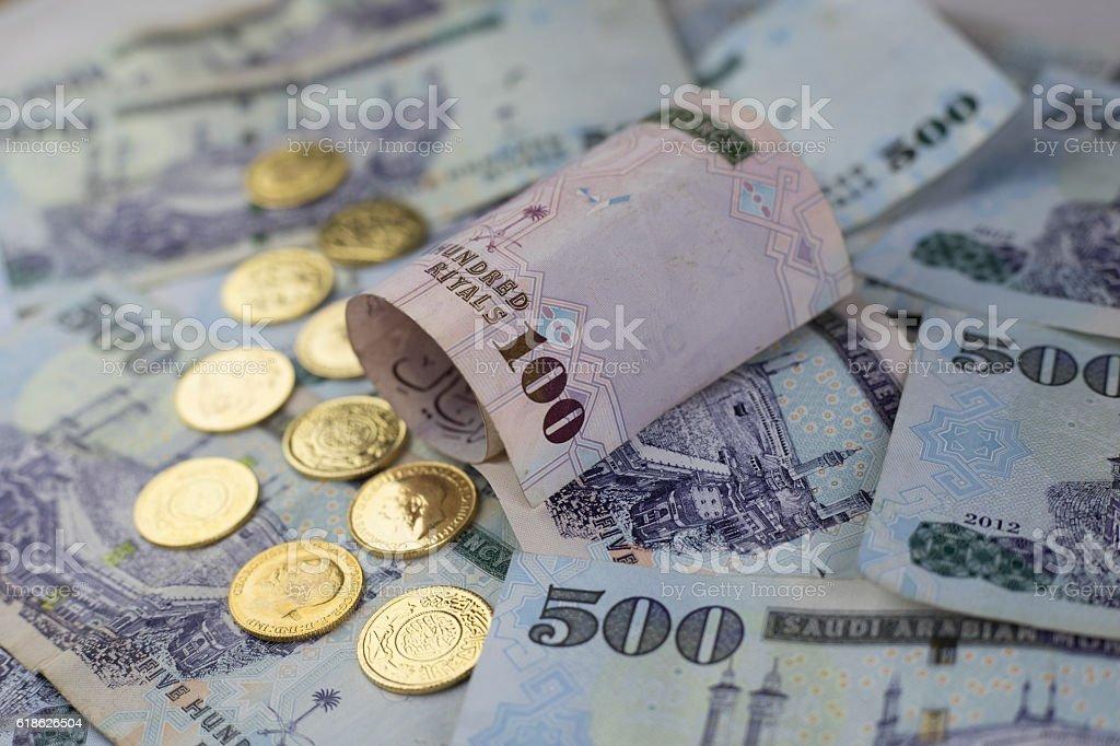 Saudi Riyal notes with Golden coins stock photo