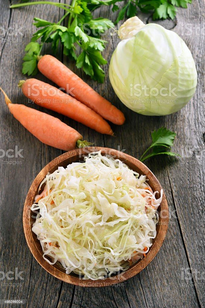 Sauerkraut and fresh vegetables stock photo