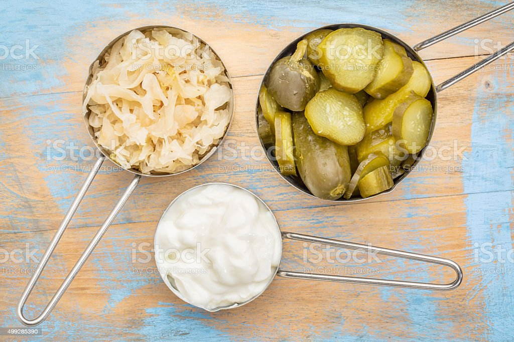sauerkraut, cucumber pickles and yogurt stock photo