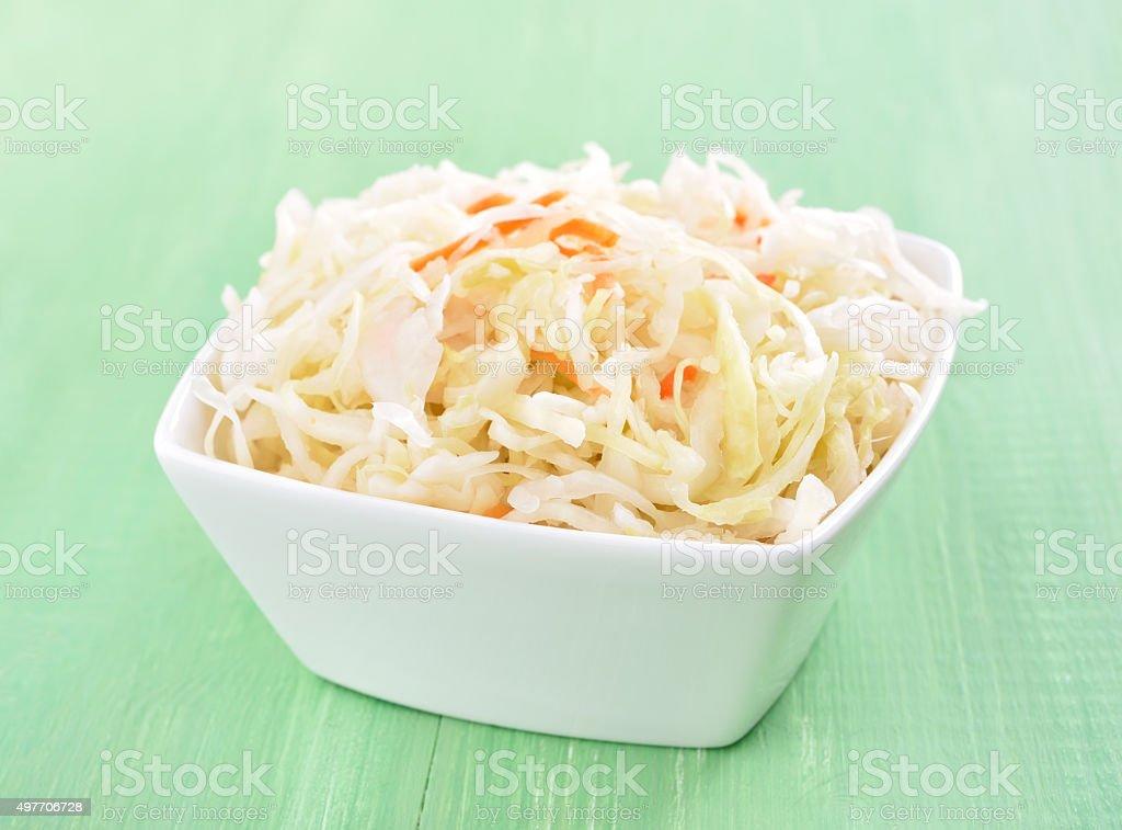 Sauerkraut in white bowl stock photo