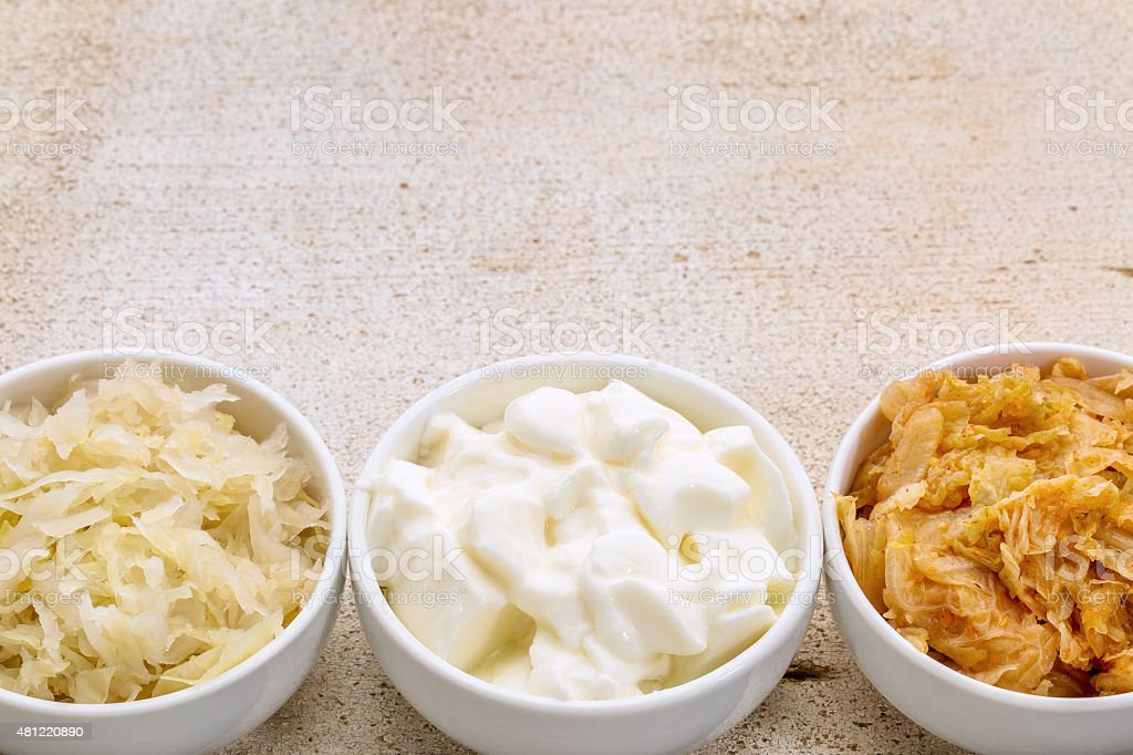 sauerkraut, kimchi and yogurt stock photo