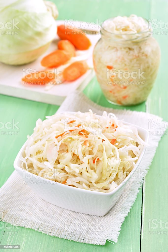 Sauerkraut on wooden green table stock photo