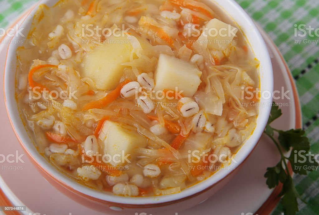 Sauerkraut soup with pearl barley stock photo