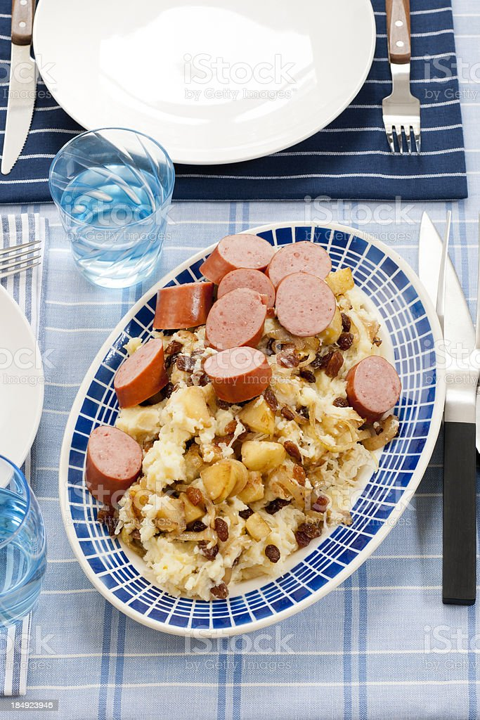 sauerkraut with apple raisins and sausage royalty-free stock photo
