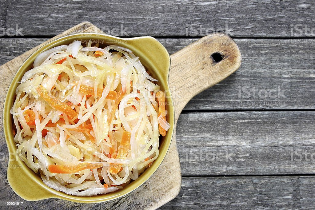 Sauerkraut with carrot in bowl stock photo