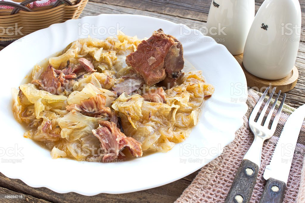 Sauerkraut with smoked pork meat stock photo