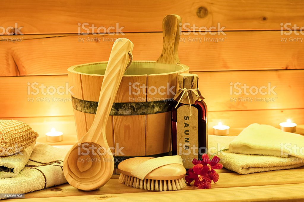Sauna accessories with sauna oil, wooden bucket, ladle stock photo