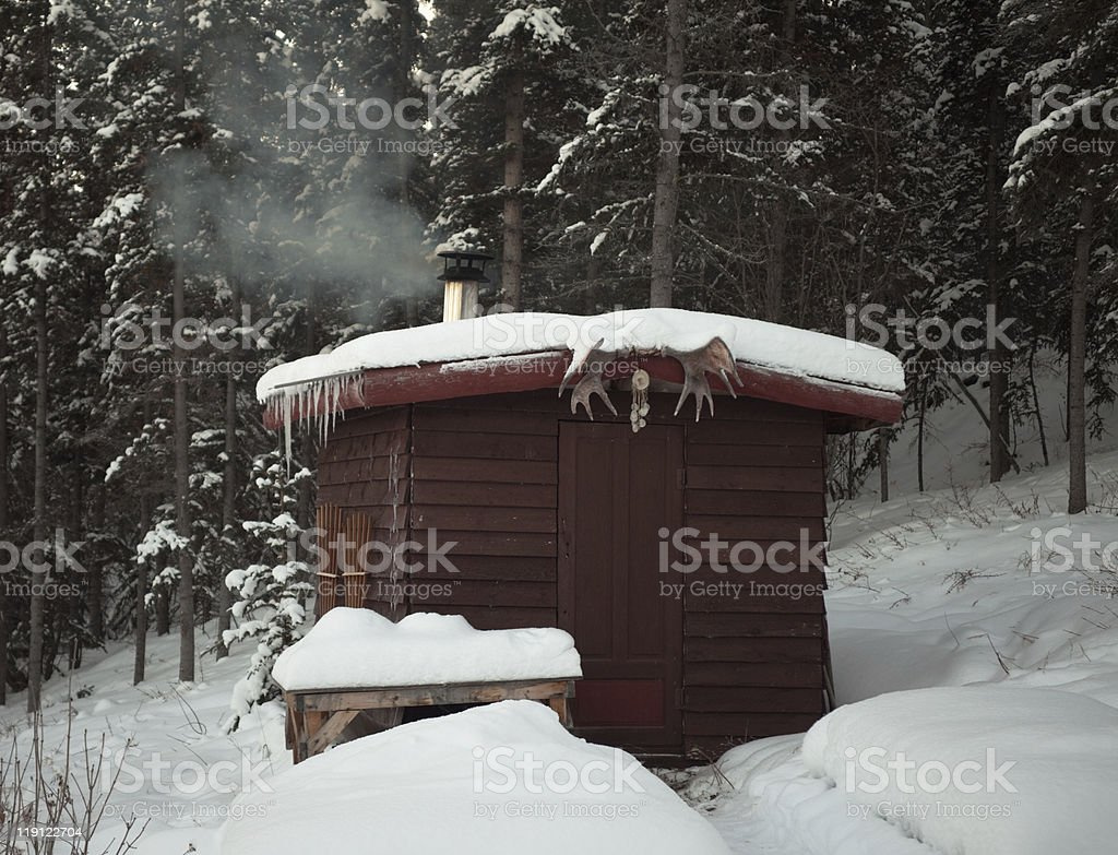 Sauna hut in winter forest royalty-free stock photo
