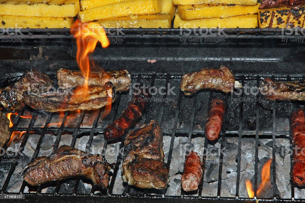 sausage and grilled pork during a barbecue in the garden royalty-free stock photo