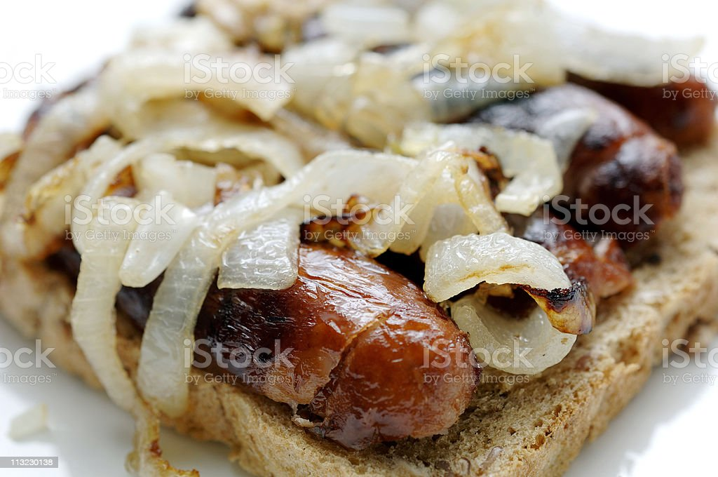 sausage and onion open sandwich on a white plate royalty-free stock photo