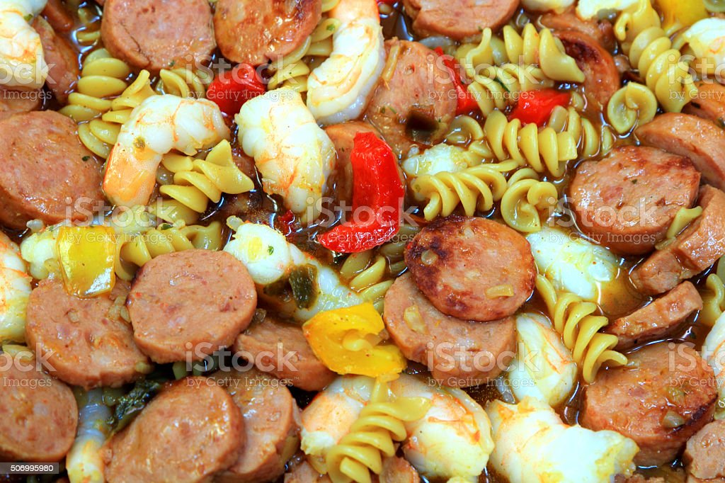 Sausage and Shrimp Jambalaya Pasta with Red and Yellow Peppers stock photo