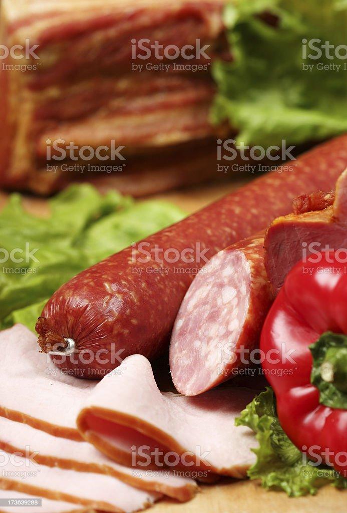 Sausage assortment, salad and paprika royalty-free stock photo