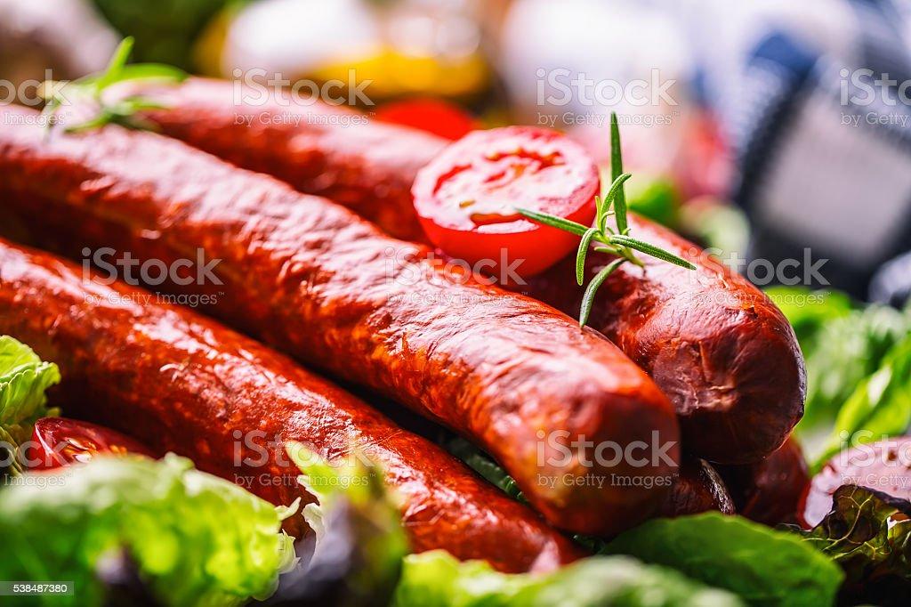 Sausage. Chorizo sausage. Raw smoked sausage with vegetable decoration. stock photo
