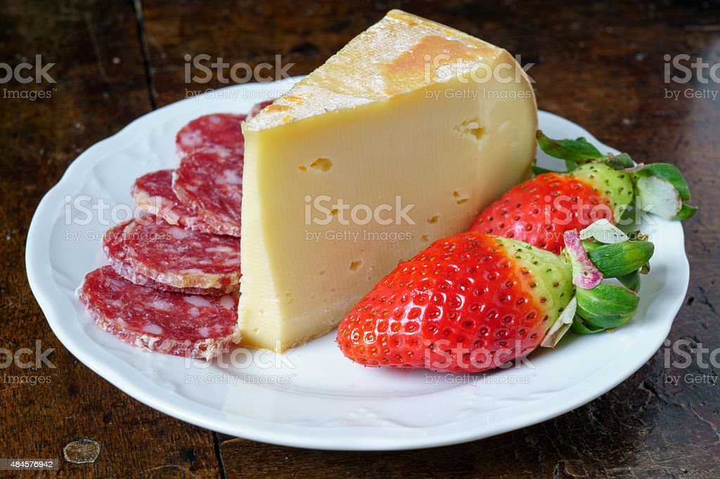 sausage fontina and strawberries stock photo