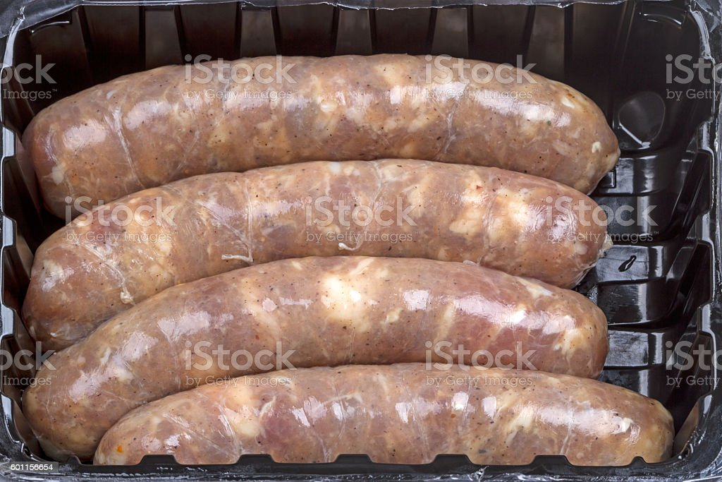 Sausage in natural casing in the package stock photo