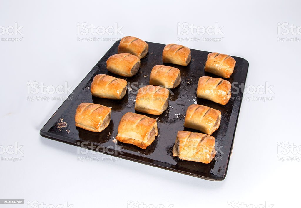 Sausage rolls,  fresh out of the oven on baking tray stock photo