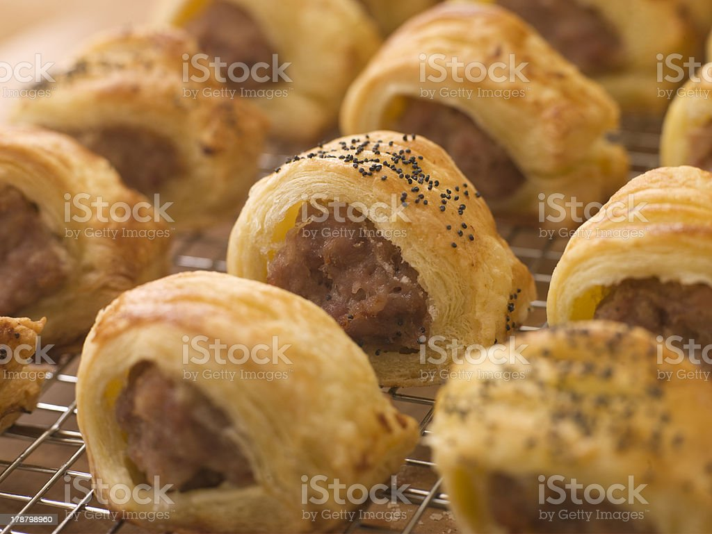 Sausage Rolls on a Cooling Rack stock photo