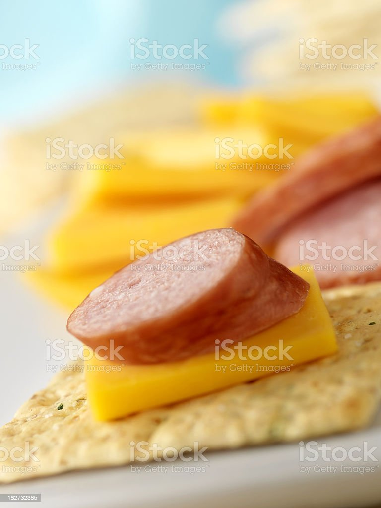 Sausage with Cheddar Cheese & Crackers stock photo