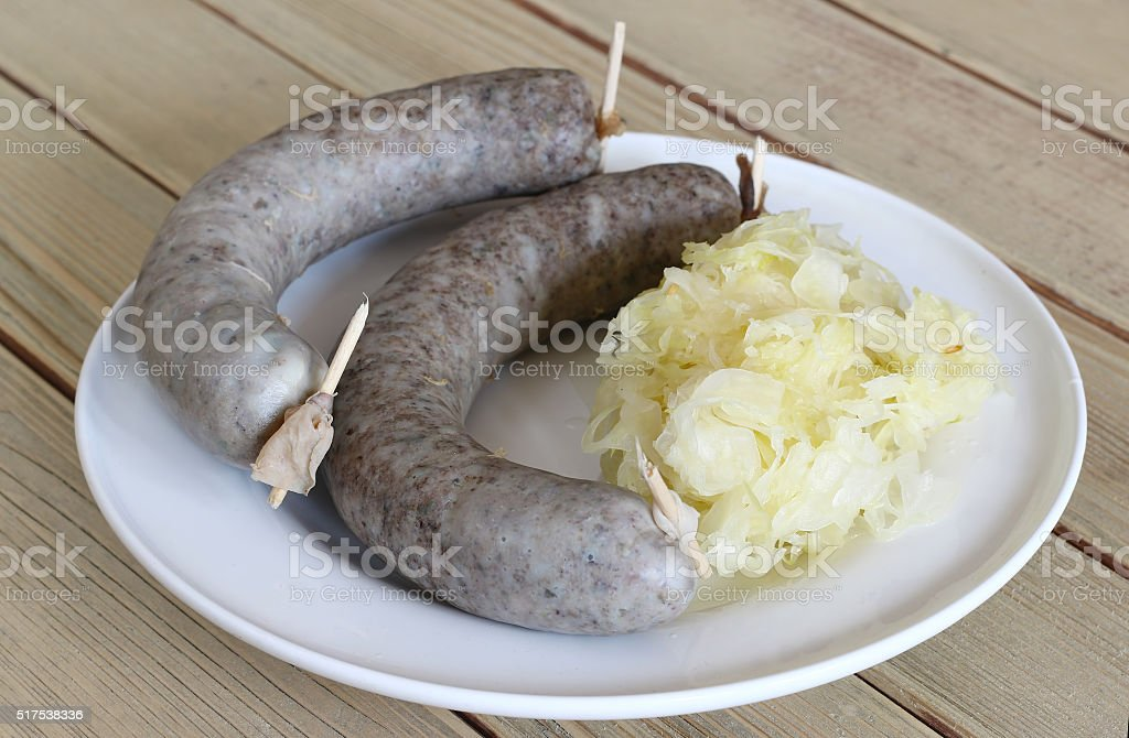 Sausage with sauerkraut stock photo