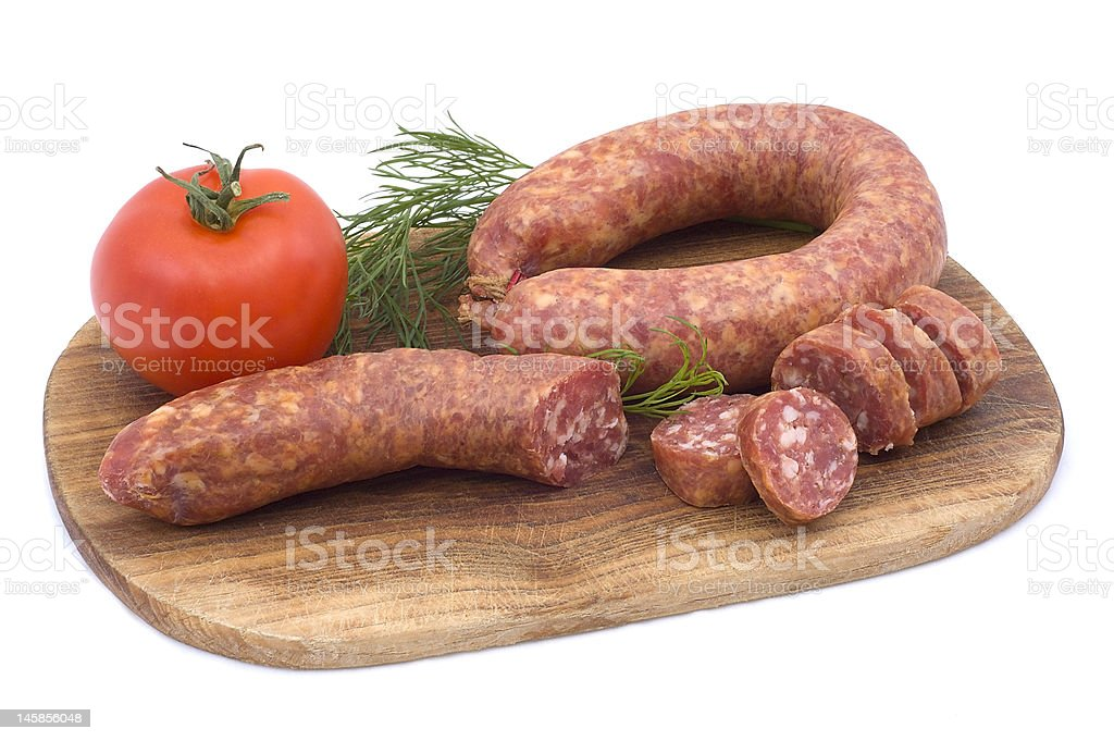 Sausage with tomato and dill royalty-free stock photo