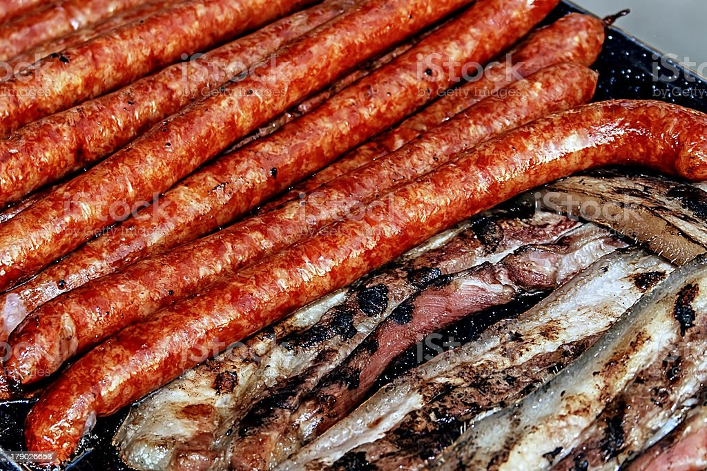Sausages and ham with fried bacon royalty-free stock photo