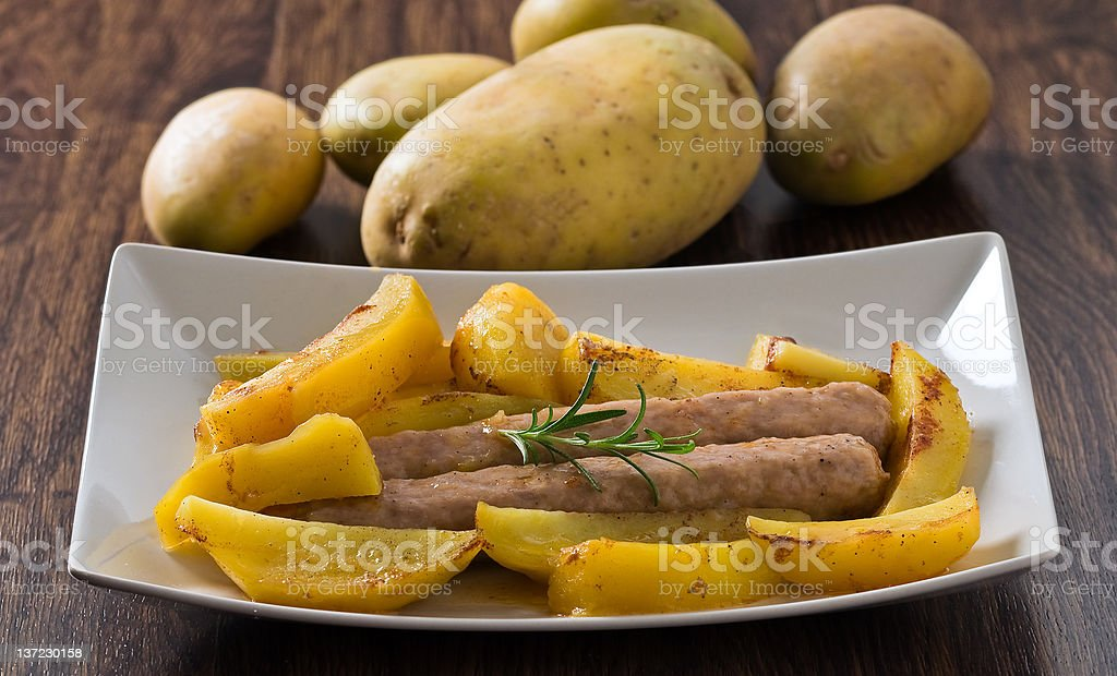 Sausages and potatoes. stock photo