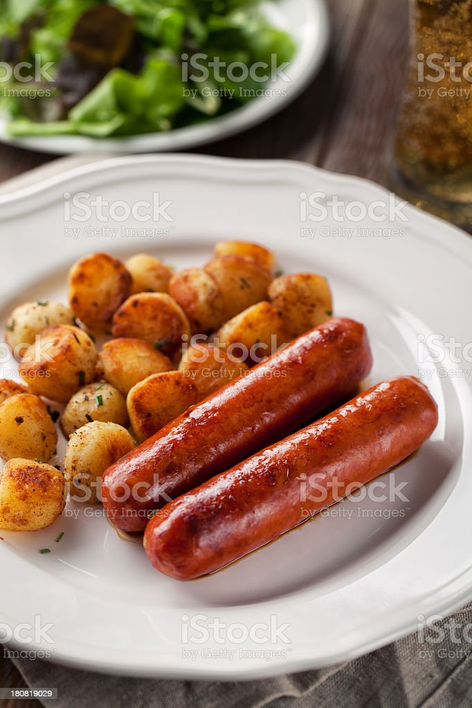 Sausages and potatoes royalty-free stock photo