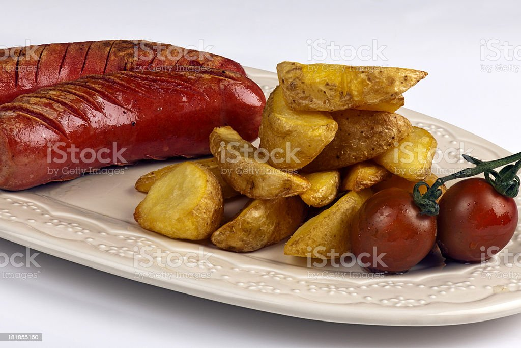 Sausages and potatoes stock photo