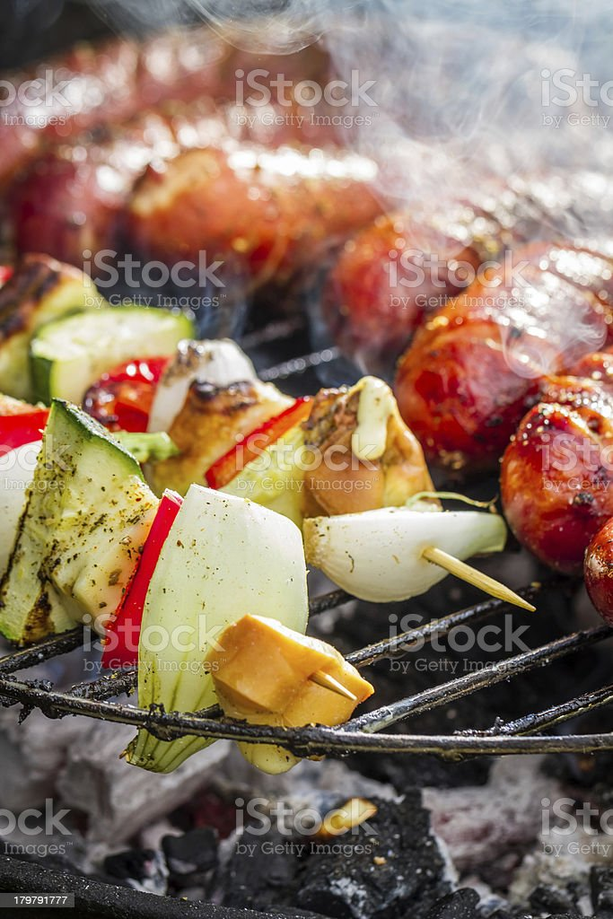 Sausages and skewers on the grill royalty-free stock photo