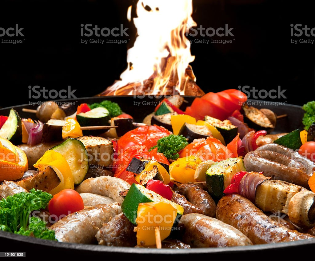 Sausages and vegetable kebab on a grill royalty-free stock photo