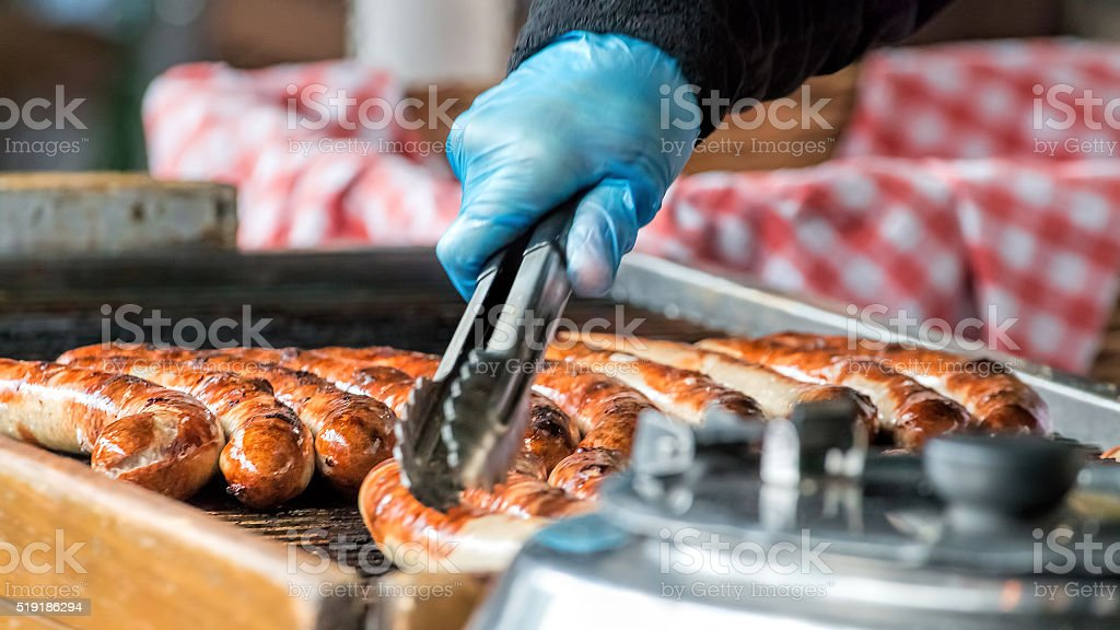 Sausages Cooking On Grill. Street Food Market Vendor stock photo