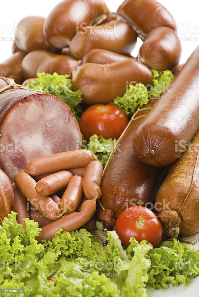 Sausages, ham with lettuce and tomatoes royalty-free stock photo