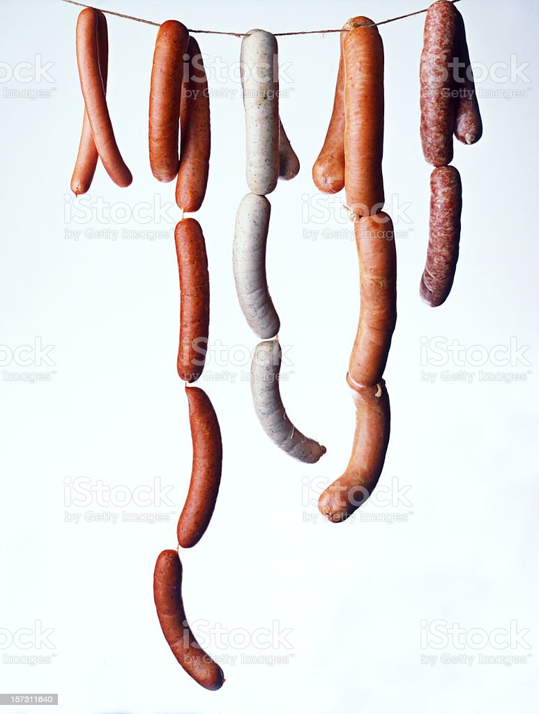 Sausages hanging on a white background stock photo