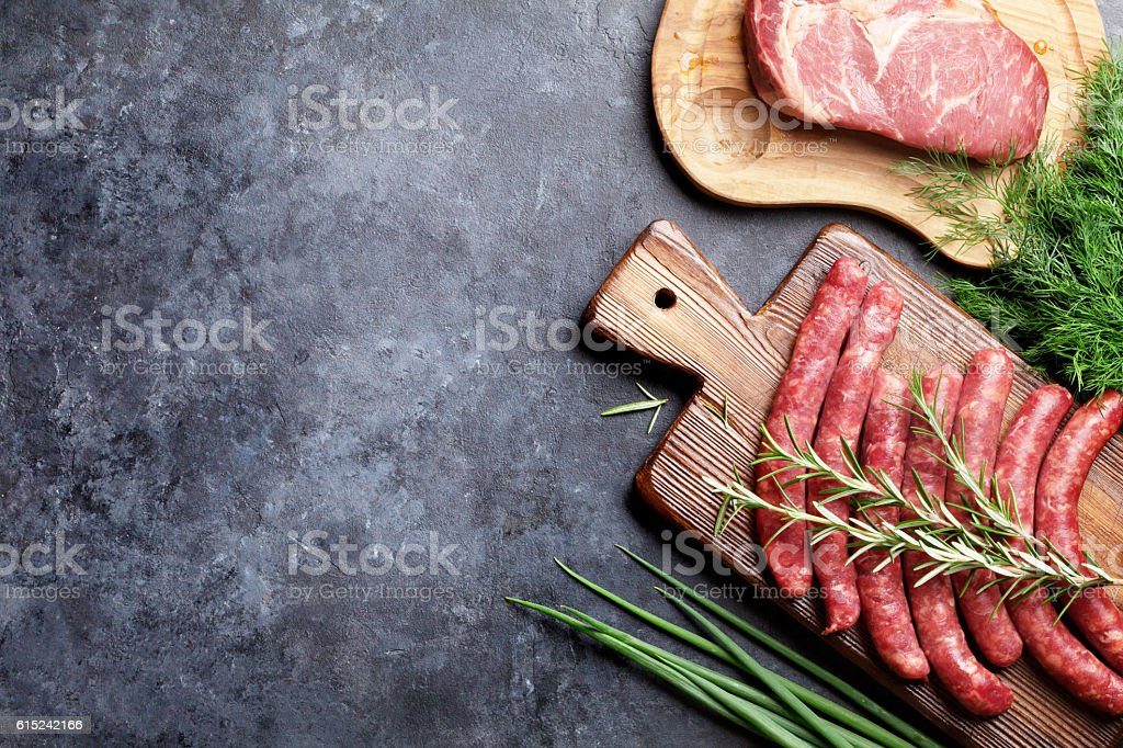 Sausages, meat and ingredients for cooking stock photo