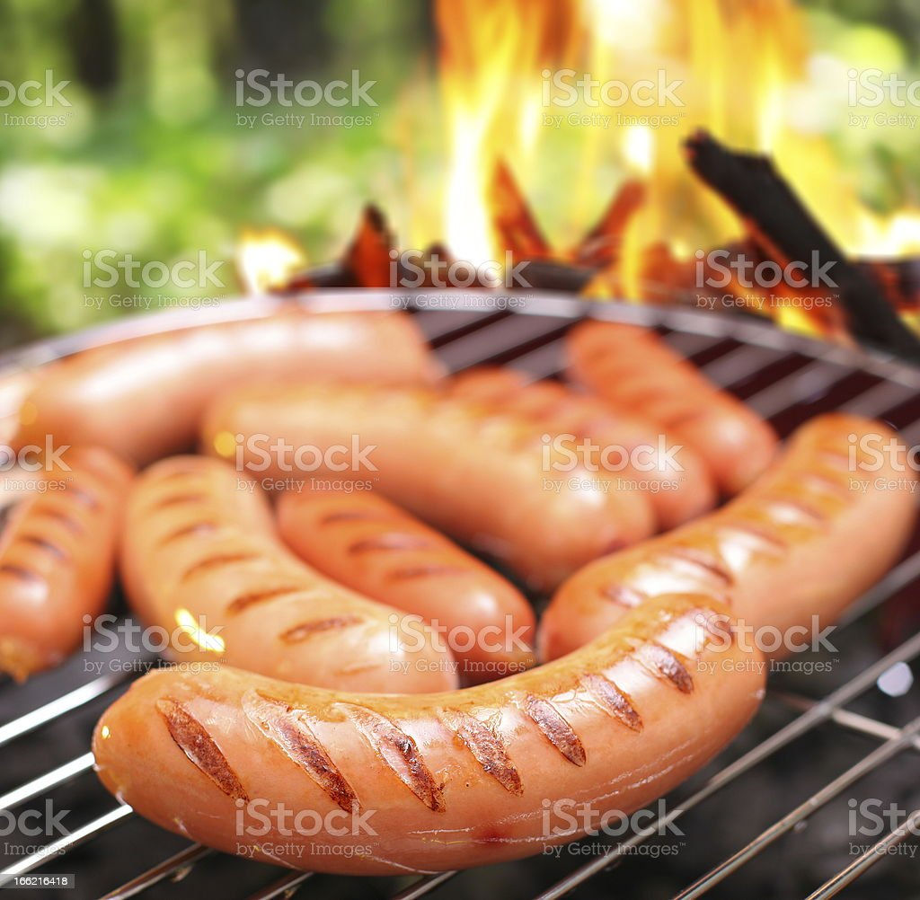 Sausages on a grill. stock photo