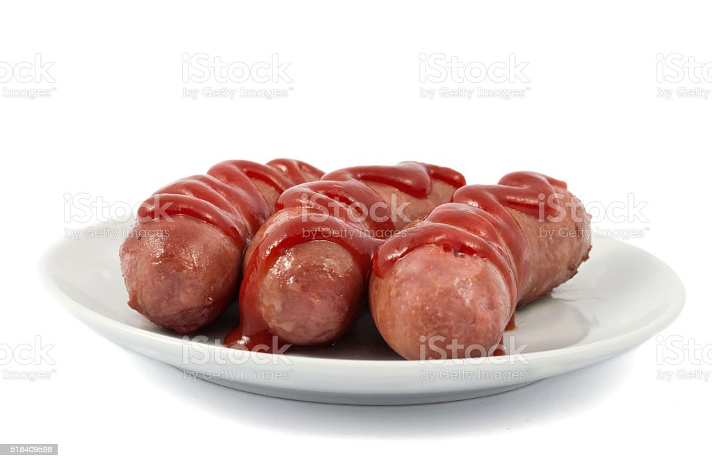 sausages on a plate stock photo