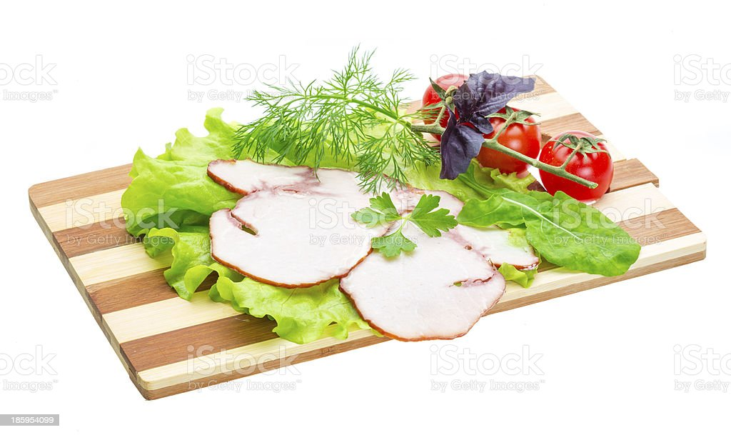 Sausages with salad and basil royalty-free stock photo