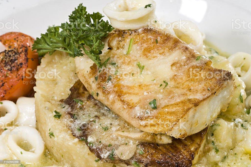 Saute filets of seabass with calamari royalty-free stock photo