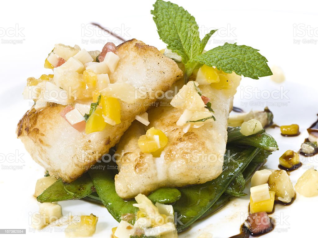 Saute Sea bass with mango-tropical fruits sauce royalty-free stock photo