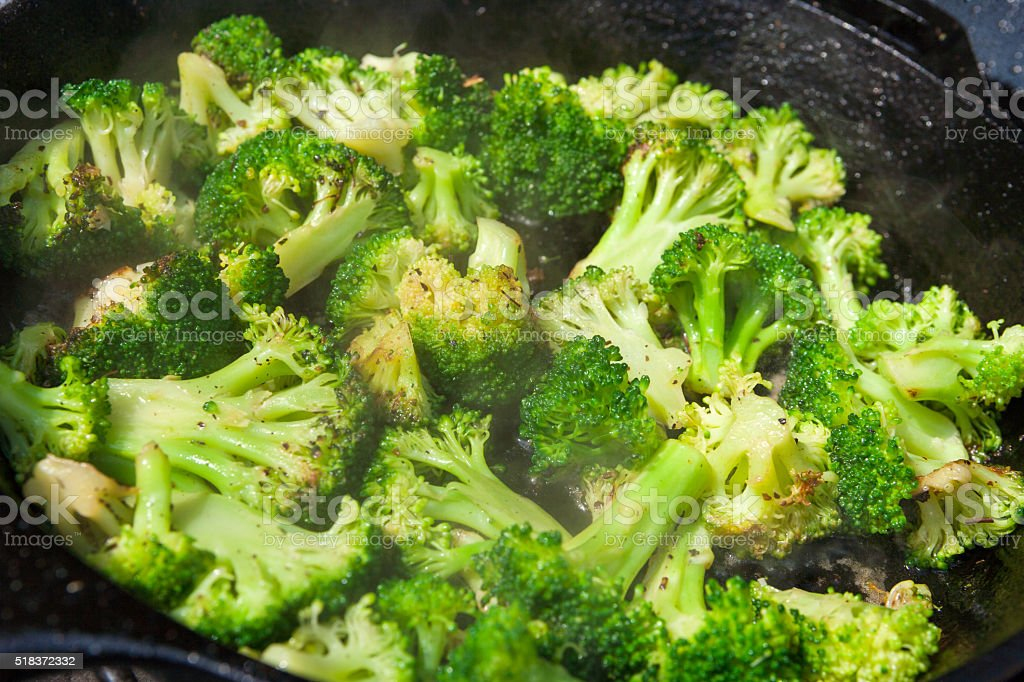 Sauted Broccoli in cast iron skillet stock photo