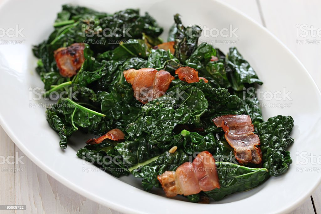 sauteed black kale and bacon stock photo