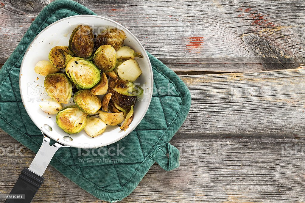 Sauteed brussels sprouts in a saucepan stock photo