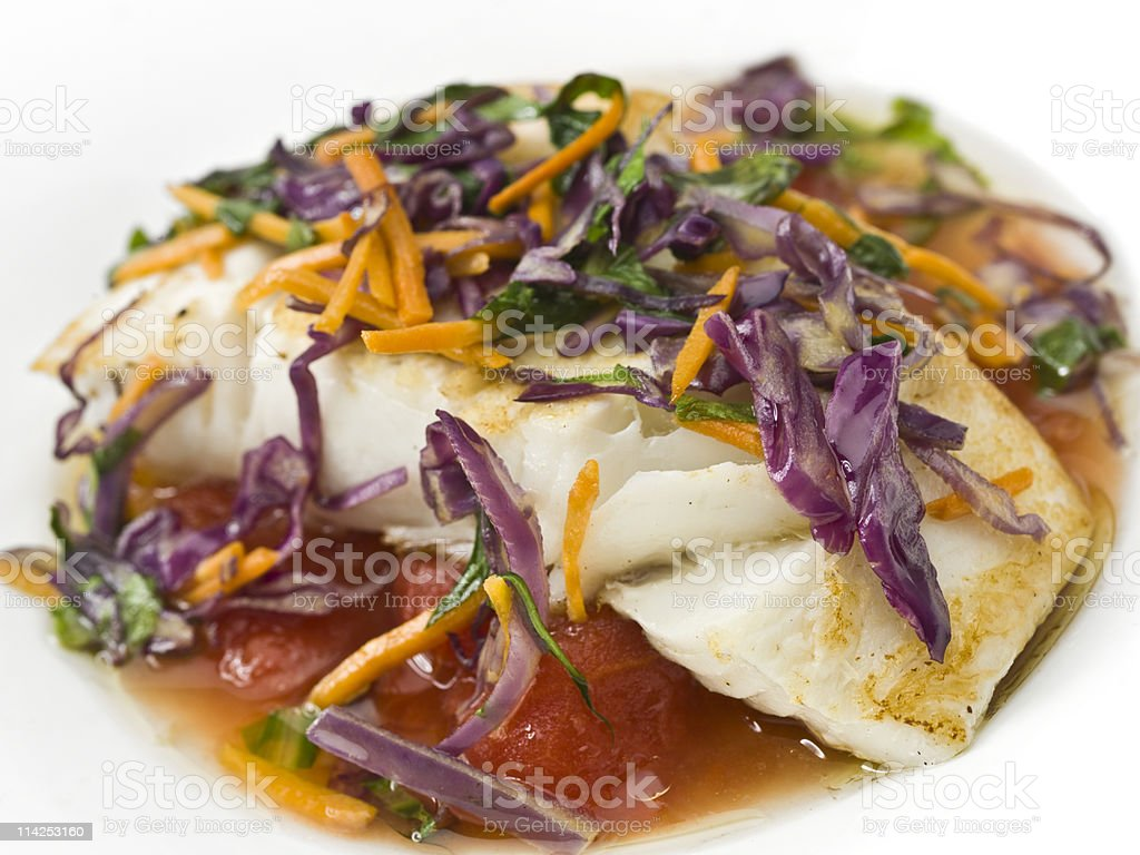 Sauteed fillet of halibut with shredded vegetables royalty-free stock photo