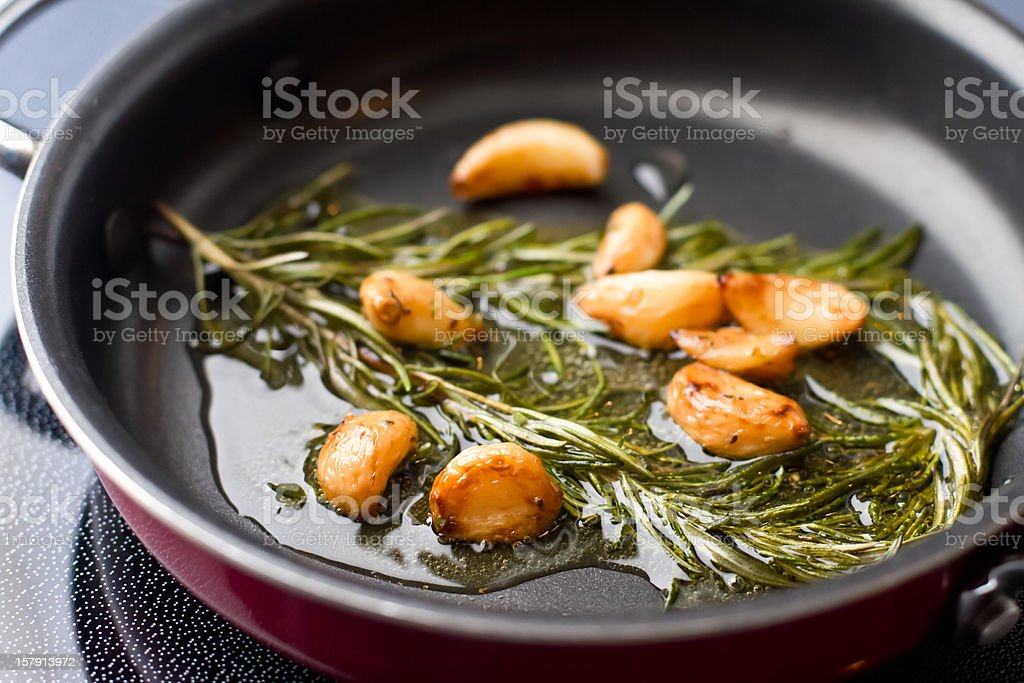 Sauteed Garlic and Rosemary in Olive OIl stock photo