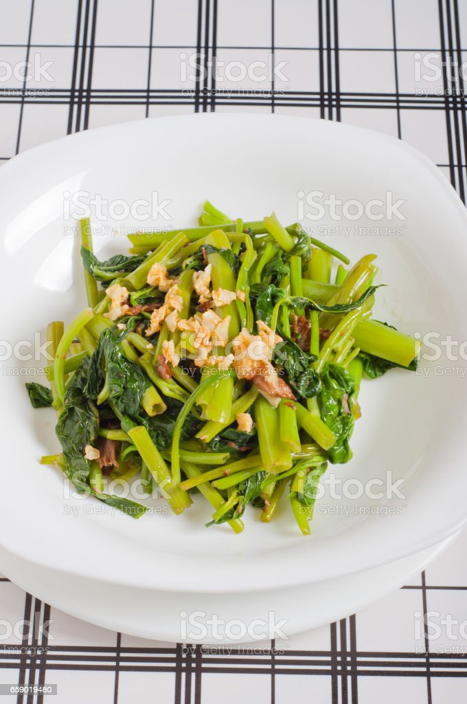sauteed garlic kangkong stock photo