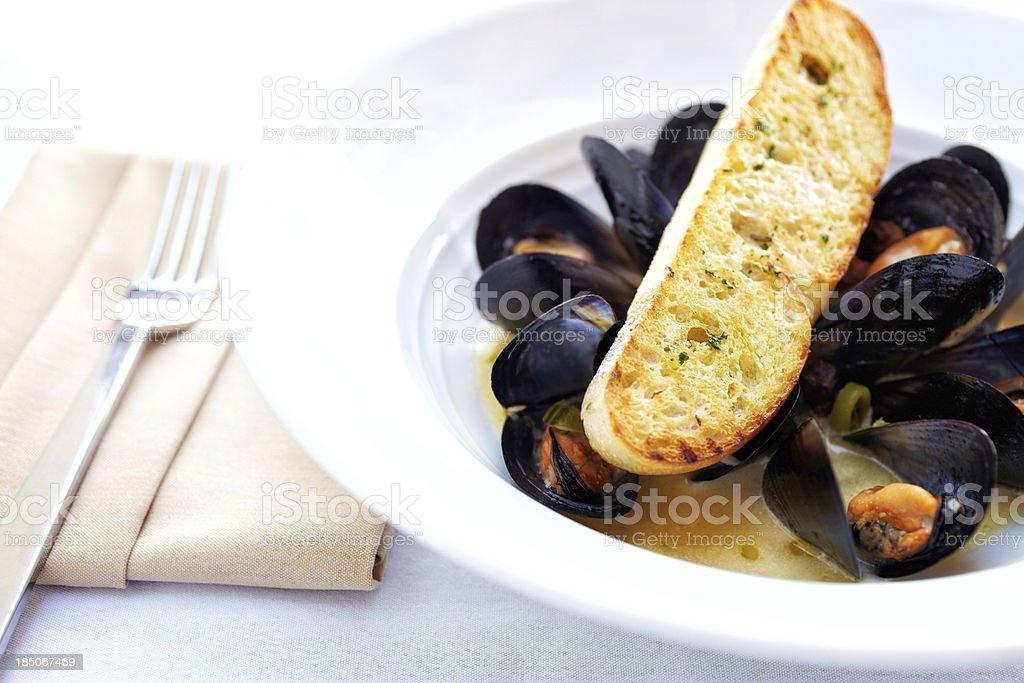 Sauteed muscles, english peas and parmesan crostini stock photo
