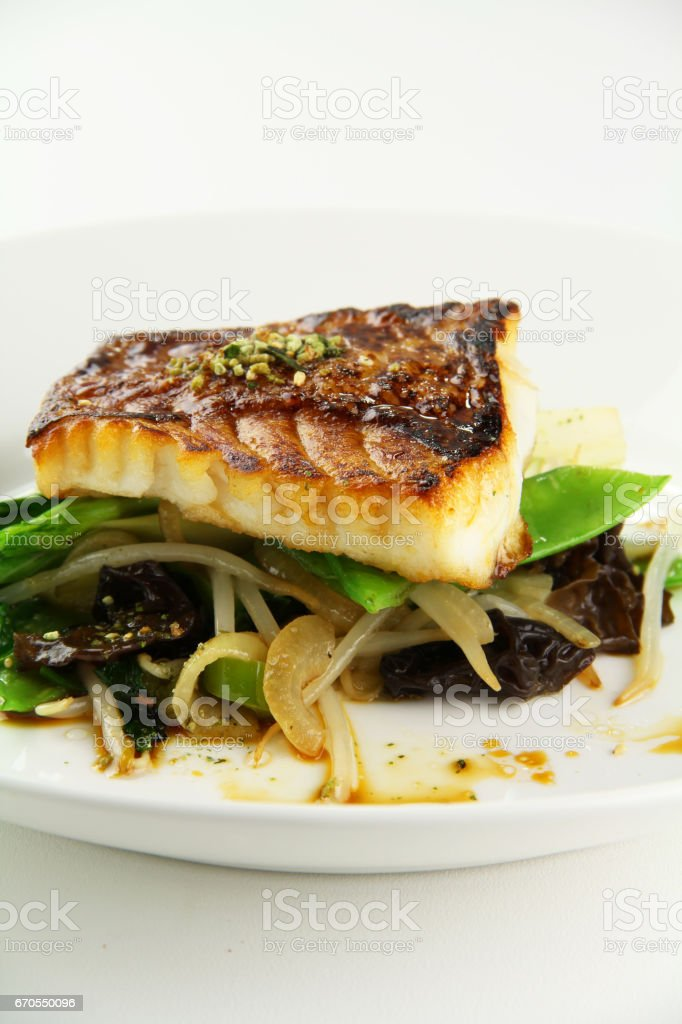 Sauteed Vermilion Rockfish with Stir Fry Vegetables stock photo